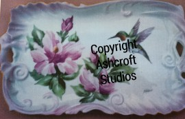 Hibiscus with hummingbird on tray